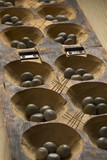 Traditional African oware game with seeds - 223194428