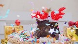A cute pig with christmas deer horns lies at basket - 223199875
