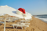 Santa Claus hat on the beach on Christmas Day. The concept of Christmas by the sea.