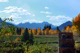 An outdoor brick oven in a back yard with an amazing view of mountains and trees in fall colors - 223212076