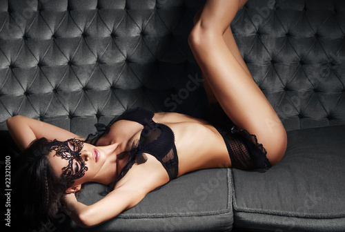 Sexy woman posing in lingerie in vintage interior