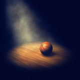 Fototapeta Sport - Ball on basketball court lit by spotlight, Basketball arena © nobeastsofierce