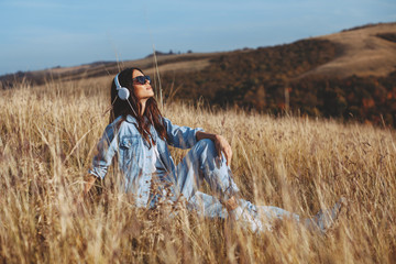 Young woman enjoys the sun in the meadow