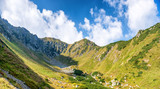 Panorama with landscape with range of green sunny mountains
