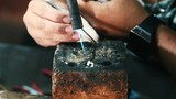 Close up - Traditional worker shaping  and fire polishing silver in a workshop in Myanmar - 223260467
