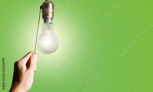 Leinwandbild Motiv Hand turning off the bulb lamp