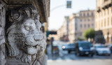 Lionhead sculpture on a wall in Rome, Italy