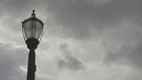 Electric lamp post against a time-lapse overcast sky. - 223278026