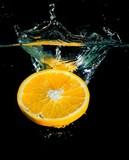 Orange Slice Splash on Black Background