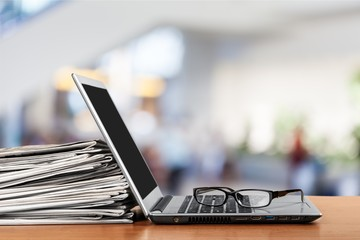 Newspapers on the laptop. Online news. Isolated