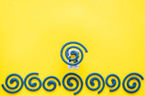 Mosquito repellent for outdoor: garden, summer house, picnic. Green spiral on yellow background top view copy space pattern - 223288691