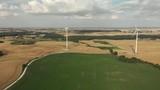 Beautiful aerial footage of wind turbines situated on farmland in Poland, 2018. - 223289056