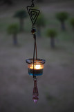 Hanging glass with candle light - 223294488