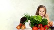 Leinwanddruck Bild - Cute little girl with vegetables in kitchen