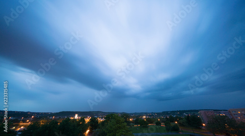 Stormy sky over a city at night - 223315485