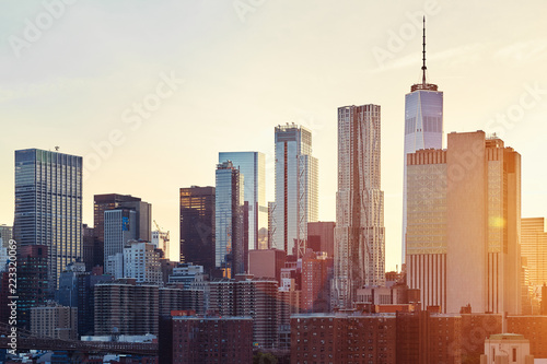 Foto Murales New York City skyline at sunset, color toned picture, USA..
