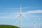 Wind turbines Blue sky and green hill in Esbjerg Denmark - 223325020
