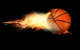 Basketball on fire on black background