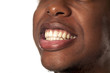 Closeup of young handsome afro american guy showing his teeth on white background