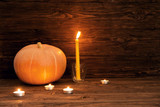 Happy Thanksgiving Day background, wooden table with Pumpkins and Candles - 223334470