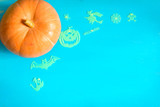 Halloween background with one pumpkin on rustic blue background, selective focus with copy space for text - 223334475
