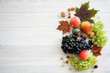 Still life of autumn fruits and vegetables. White wooden background