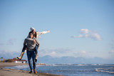 couple having fun at beach during autumn - 223372082