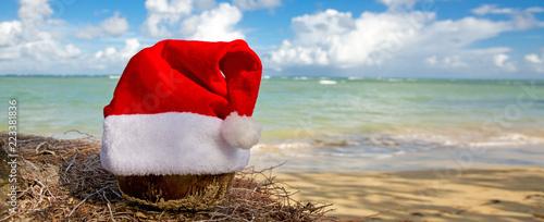 Santa Claus hat on caribbean beach. Christmas background - 223381836