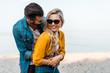 Leinwanddruck Bild - boyfriend hugging happy girlfriend on beach