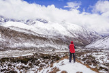 Hiker enjoys the view of Himalayas mountains in Nepal.