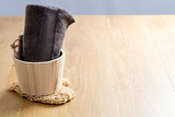 genuine wellness concept with towel, wooden bucket and rustic loofah - 223393431
