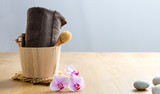 towel, brush, orchids and zen pebbles for detox and wellness - 223394675