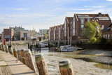 inner harbor at low tide in the old town of Husum on a sunny day, north sea coast in germany - 223398288