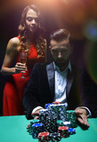 woman and man at the poker table with chips and drinks - 223401873