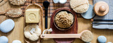 exfoliation still life with many brushes, loofah and massage objects - 223407004