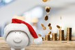 Piggy bank in christmas hat and coins