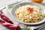 Spicy parboiled rice with carrots, yellow zucchini and chilli peppers - 223411495