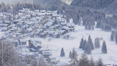 Small Italian town in the Dolomites near Ski Center Latemar in the snow