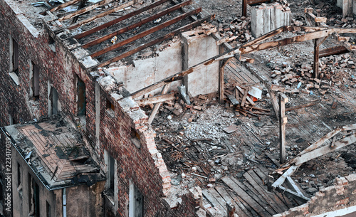 Foto Murales Color toned picture of a destroyed building, disaster concept.