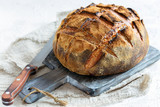 Loaf of bread on sourdough from wheat and rye flour. - 223419230