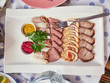 Cold cuts on a plate - 223420693