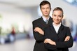 Young business couple in black suits in