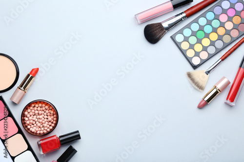 Different makeup cosmetics on grey background
