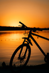 bicycle on the background of a sunset