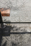 Damaged glass at bus stop shelter - 223434456