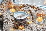 hot cappuccino with candles and lights at knitted background - 223437478