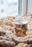hot cappuccino with candles and lights at knitted background - 223437491