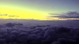 Flying above the clouds at dawn at jetspeed - 223450445