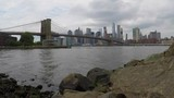 A view of the New York City skyline and the Brooklyn Bridge from across the river. It was a cloudy and rainy day. - 223455010