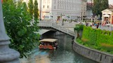 boat travels on a city river in ljubljana summer afternoon - 223459479